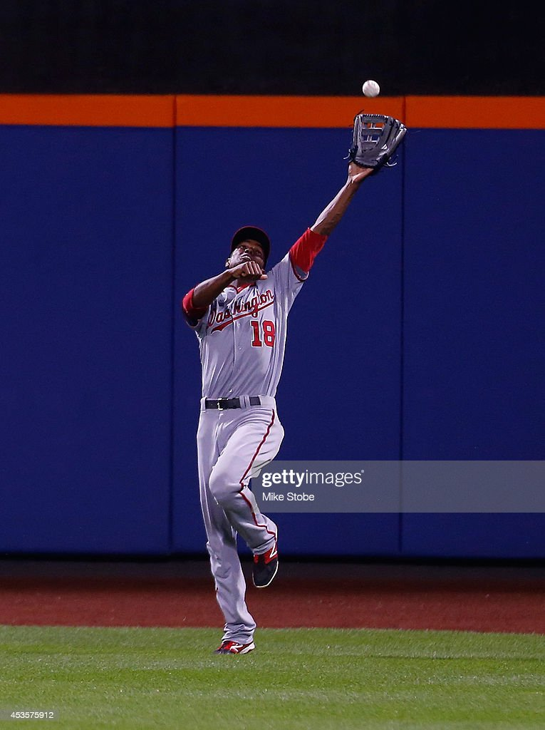Michael Taylor #18 of the Washington Nationals runs down a fly ball off the bat of <a gi-track='captionPersonalityLinkClicked' href=/galleries/search?phrase=Juan+Lagares&family=editorial&specificpeople=8960493 ng-click='$event.stopPropagation()'>Juan Lagares</a> #12 of the New York Mets (not pictured) in the fifth inning at Citi Field on August 13, 2014 in the Flushing neighborhood of the Queens borough of New York City.