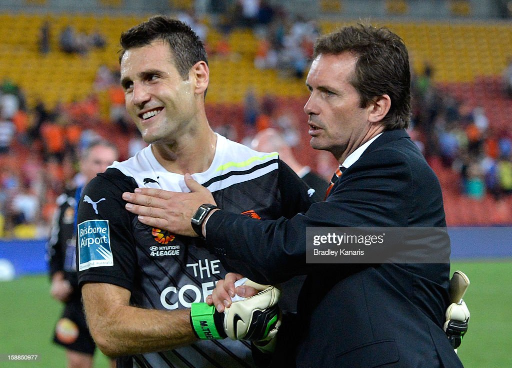 Michael Theo of the Roar celebrates victory with his coach Mike Mulvey after the round 14 A-League match between the Brisbane Roar and the Wellington Phoenix at Suncorp Stadium on January 1, 2013 in Brisbane, Australia.