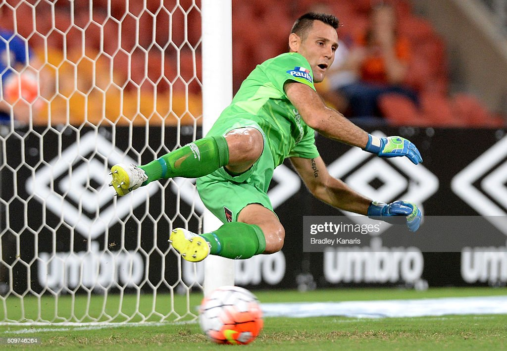 Michael Theo of the Roar is unable to stop this penalty goal by Milos Trifunovic of the Jets during the round 19 A-League match between the Brisbane Roar and the Newcastle Jets at Suncorp Stadium on February 12, 2016 in Brisbane, Australia.