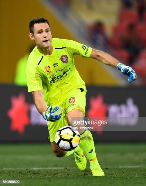 Michael Theo of the Roar looks to distribute the ball after making a save during the round two ALeague match between the Brisbane Roar and Adelaide...