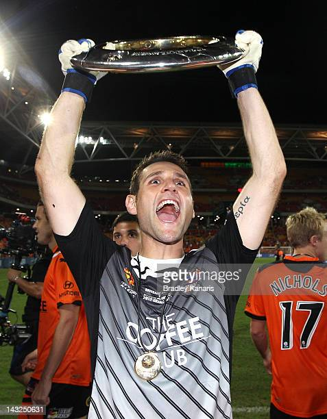 Michael Theoklitos of the Roar celebrates victory as he holds up the winners trophy after the 2012 ALeague Grand Final match between the Brisbane...