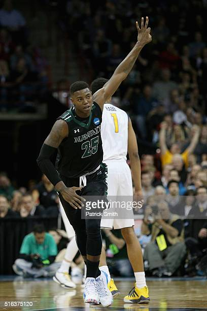 Michael Thomas of the Hawaii Warriors celebrates after hitting a three pointer in the second half against the California Golden Bears during the...