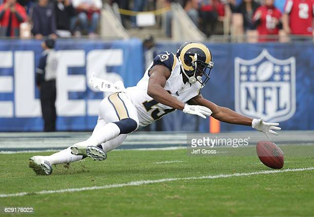 Michael Thomas of the Los Angeles Rams fumbles the opening kick off against the Atlanta Falcons in the first quarter at Los Angeles Memorial Coliseum...