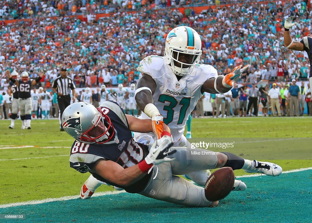 Michael Thomas #31 of the Miami Dolphins blocks a pass from Danny Amendola #80 of the New England Patriots on the final drive during a game at Sun Life Stadium on December 15, 2013 in Miami Gardens, Florida.