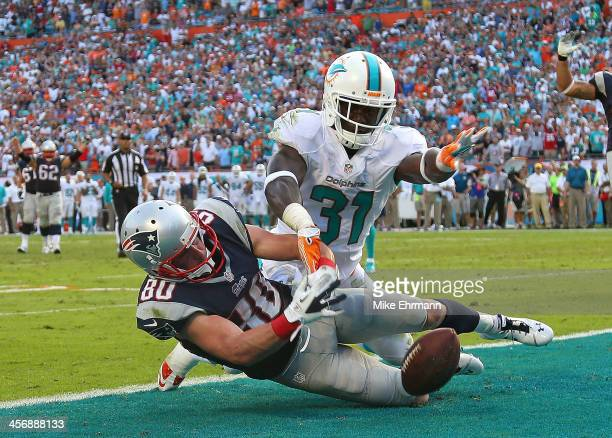 Michael Thomas of the Miami Dolphins blocks a pass from Danny Amendola of the New England Patriots on the final drive during a game at Sun Life...