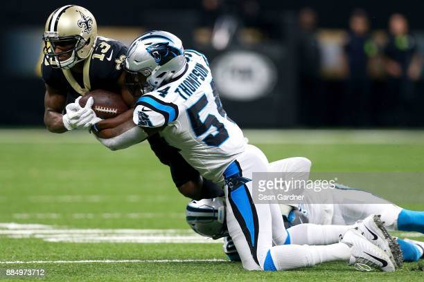 Michael Thomas of the New Orleans Saints is tackled by Shaq GreenThompson of the Carolina Panthers during the second half of a NFL game at the...