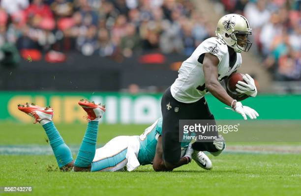 Michael Thomas of the New Orleans Saints tackled by Cordrea Tankersley of the Miami Dolphins during the NFL game between the Miami Dolphins and the...