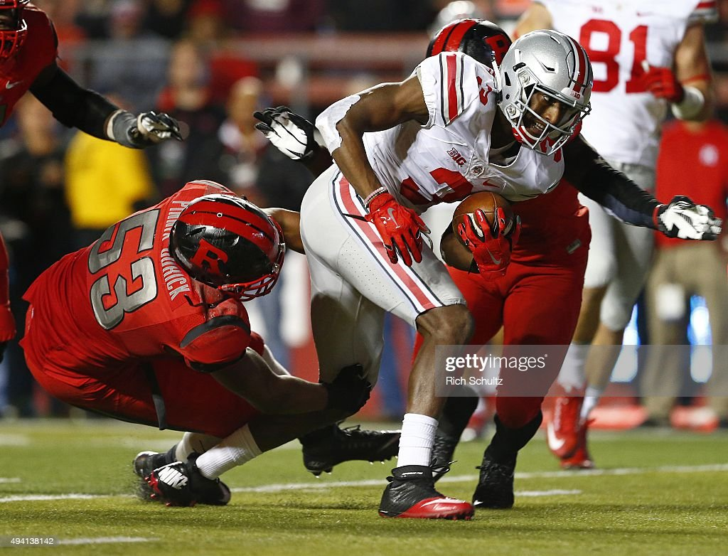 Michael Thomas #3 of the Ohio State Buckeyes runs with the ball as Julian Pinnix-Odrick #53 and Steve Longa #3 of the Rutgers Scarlet Knights during the second quarter at High Point Solutions Stadium on October 24, 2015 in Piscataway, New Jersey. Ohio State defeated Rutgers 49-7.