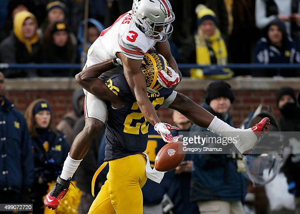 Michael Thomas of the Ohio State Buckeyes tries to come up with a fourth quarter catch behind Jourdan Lewis of the Michigan Wolverines at Michigan...