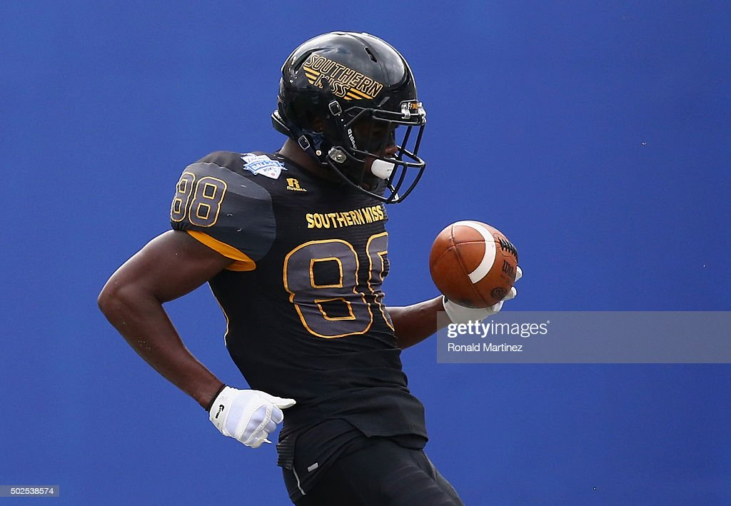 Michael Thomas of the Southern Miss Golden Eagles celebrates a touchdown against the Washington Huskies during the Zaxby's Heart of Dallas Bowl at...