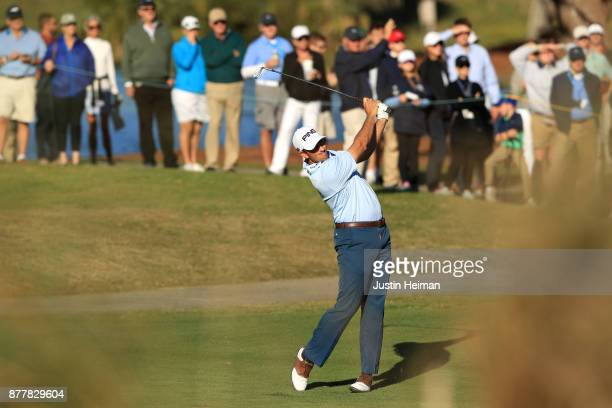 Michael Thompson of the United States plays his second shot on the 18th hole during the final round of The RSM Classic at Sea Island Golf Club...