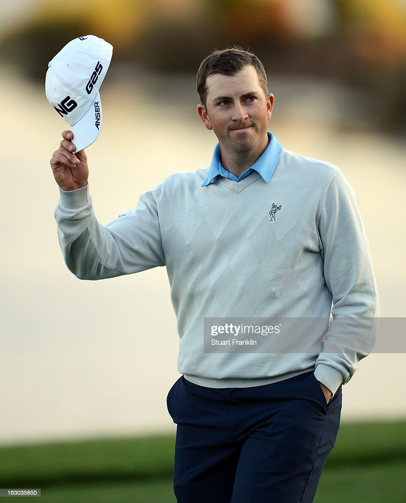 Michael Thompson of USA waves to the fans on the 18th hole during the final round of the Honda Classic on March 3, 2013 in Palm Beach Gardens, Florida.
