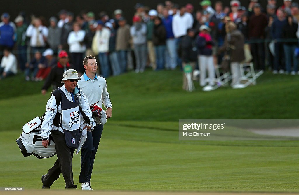 Michael Thompson walks with caddy Matt Bednarski up the 18th hole during the final round of the Honda Classic at PGA National Resort and Spa on March 3, 2013 in Palm Beach Gardens, Florida.