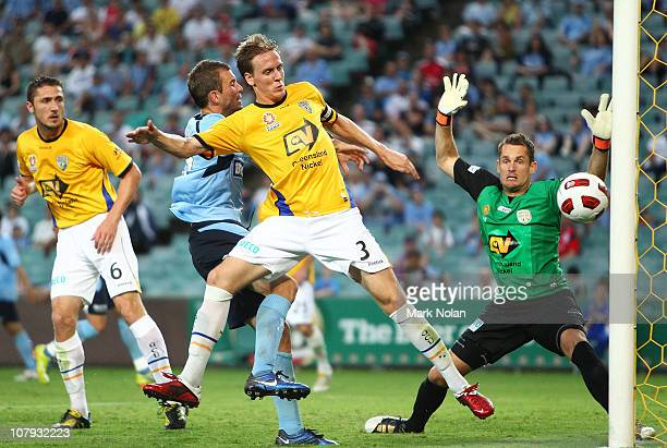 Michael Thwaite and Glen Moss of the Gold Coast defend the goal during the round 22 ALeague match between Sydney FC and Gold Coast United at Sydney...
