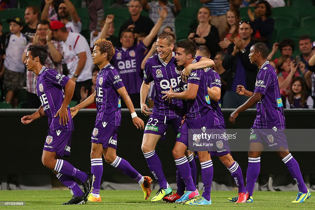 Michael Thwaite and Jamie Maclaren of the Glory celebrate a goal during the round seven A-League match between Perth Glory and the Central Coast Mariners at nib Stadium on November 23, 2013 in Perth, Australia.