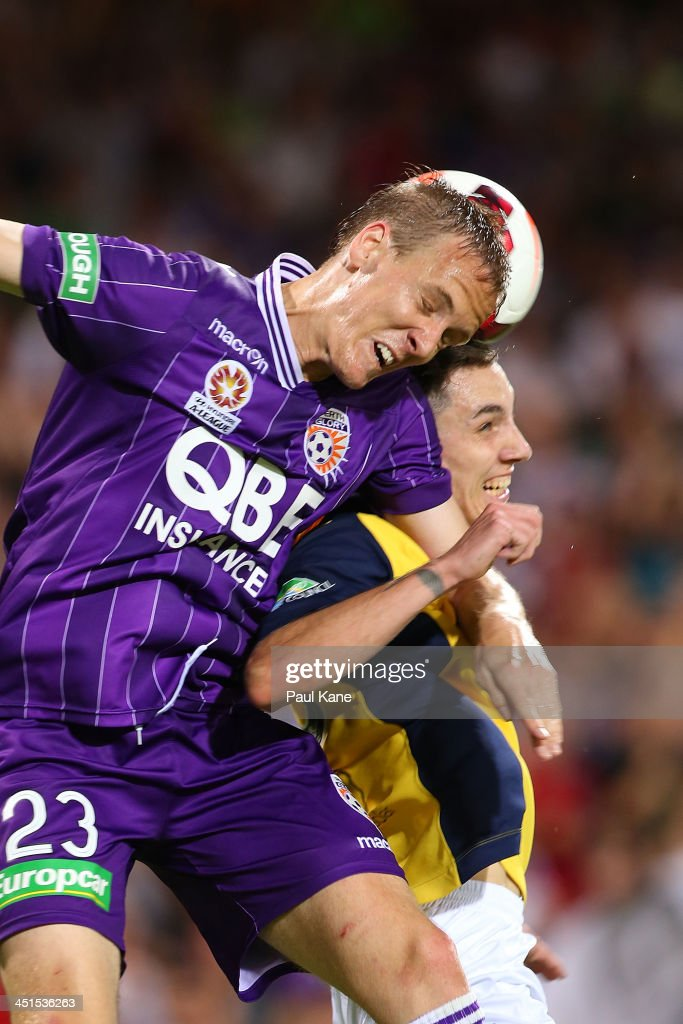 Michael Thwaite of the Glory and Storm Roux of the Mariners contest for the ball during the round seven A-League match between Perth Glory and the Central Coast Mariners at nib Stadium on November 23, 2013 in Perth, Australia.