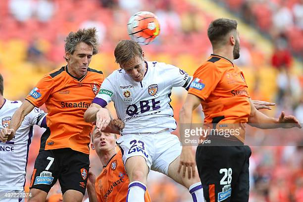 Michael Thwaite of the Glory heads the ball during the round six ALeague match between Brisbane Roar and Perth Glory at Suncorp Stadium on November...