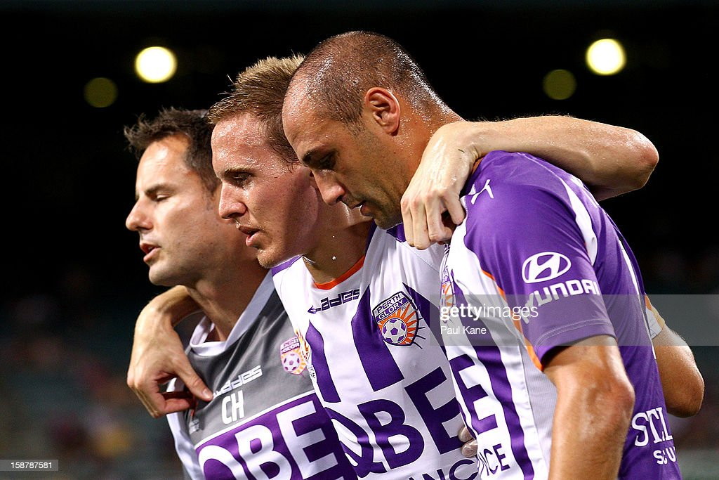 Michael Thwaite of the Glory is assisted from the field by a trainer and Billy Mehmet during the round 13 A-League match between the Perth Glory and the Western Sydney Wanderers at Patersons Stadium on December 27, 2012 in Perth, Australia.