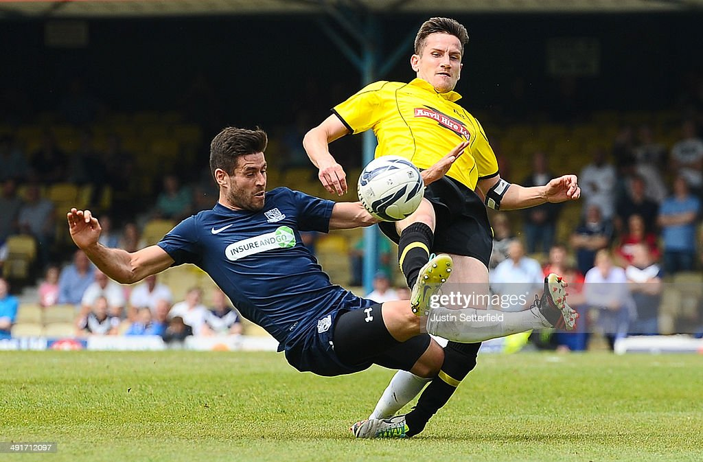 Michael Timlin of Southend United and Lee Bell of Burton Albion in action during the Sky Bet League 2 Play Off Semi Final second leg match between Southend United and Burton Albion at Roots Hall on May 17, 2014 in Southend, England.