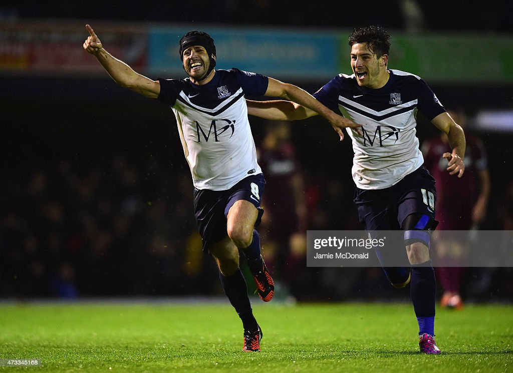 Michael Timlin of Southend United celebrates with Ryan Leonard as he scores their third goal during the Sky Bet League Two Playoff semi final match...