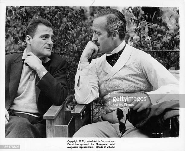 Michael Todd looking over at David Niven in between scenes from the film 'Around The World In Eighty Days' 1956