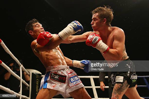 Michael 'Tomahawk' Thompson punches Ghot Seur Noi during Total Carnage IV at the Gold Coast Convention and Exhibition Centre on December 14 2013 in...