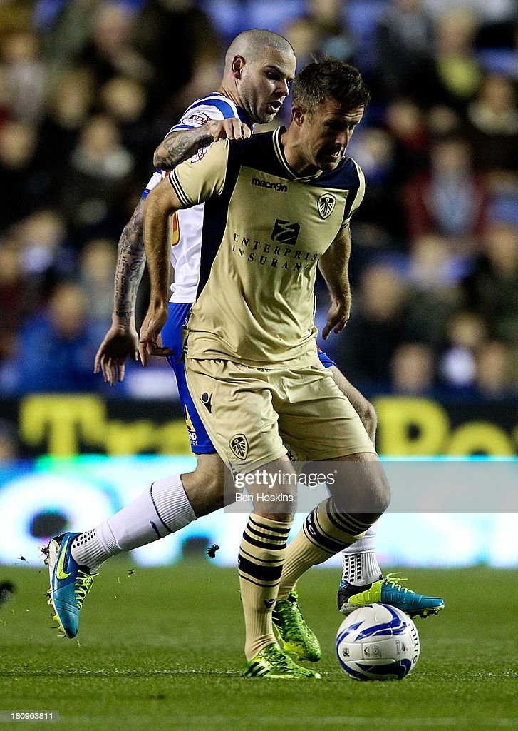 Michael Tonge of Leeds holds off the challenge of Danny Guthrie of Reading during the Sky Bet Championship match between Reading and Leeds United at Madejski Stadium on September 18, 2013 in Reading, England.