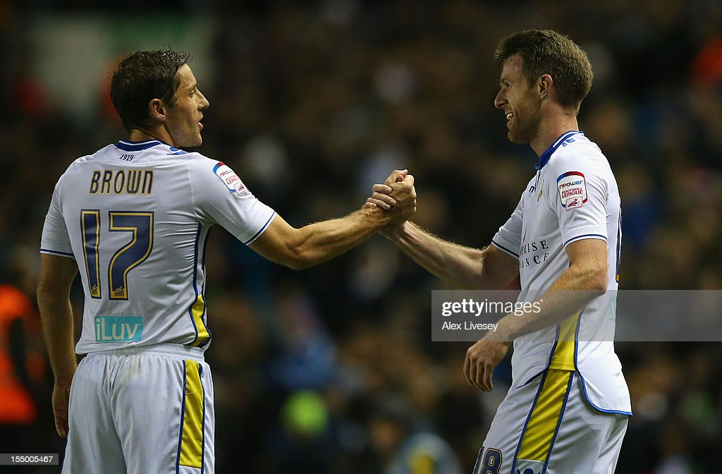 <a gi-track='captionPersonalityLinkClicked' href=/galleries/search?phrase=Michael+Tonge&family=editorial&specificpeople=196528 ng-click='$event.stopPropagation()'>Michael Tonge</a> of Leeds United celebrates scoring the opening goal with team-mate Michael Brown during the Capital One Cup Fourth Round match between Leeds United and Southampton at Elland Road on October 30, 2012 in Leeds, England.