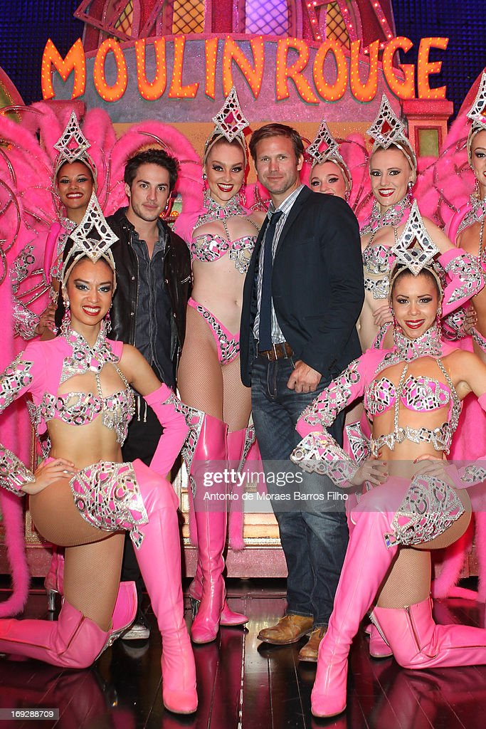 <a gi-track='captionPersonalityLinkClicked' href=/galleries/search?phrase=Michael+Trevino&family=editorial&specificpeople=4069456 ng-click='$event.stopPropagation()'>Michael Trevino</a> and Matthew Davis pose backstage with the dancers of the Moulin Rouge after they have attended the show at Le Moulin Rouge on May 22, 2013 in Paris, France.
