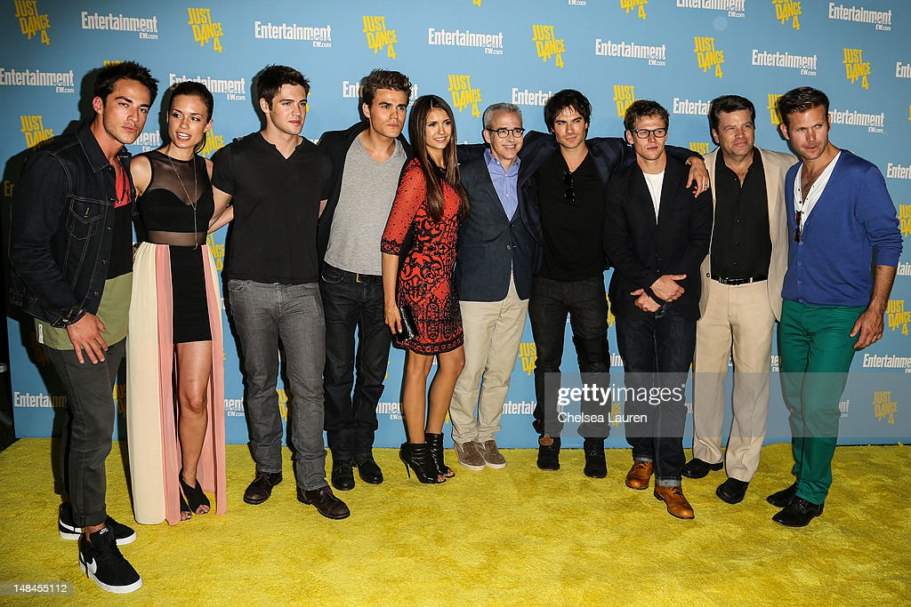 Michael Trevino, Torrey DeVitto, Steven R. McQueen, Paul Wesley, Nina Dobrev, editor of Entertainment Weekly Jess Cagle, Ian Somerhalder, Zach Roerig, a guest, and Matthew Davis arrive at Entertainment Weekly's Comic-Con celebration at Float at Hard Rock Hotel San Diego on July 14, 2012 in San Diego, California.