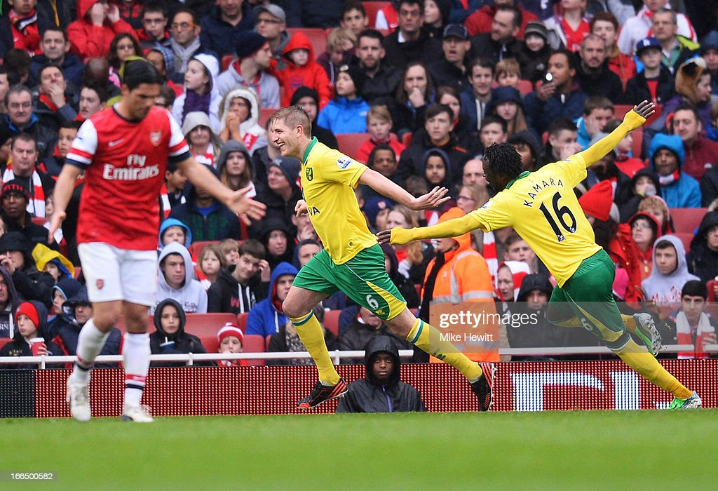 Michael Turner of Norwich City celebrates scoring the first goal of the match with teammate <a gi-track='captionPersonalityLinkClicked' href=/galleries/search?phrase=Kei+Kamara&family=editorial&specificpeople=4405555 ng-click='$event.stopPropagation()'>Kei Kamara</a> during the Barclays Premier League match between Arsenal and Norwich City at Emirates Stadium on April 13, 2013 in London, England.