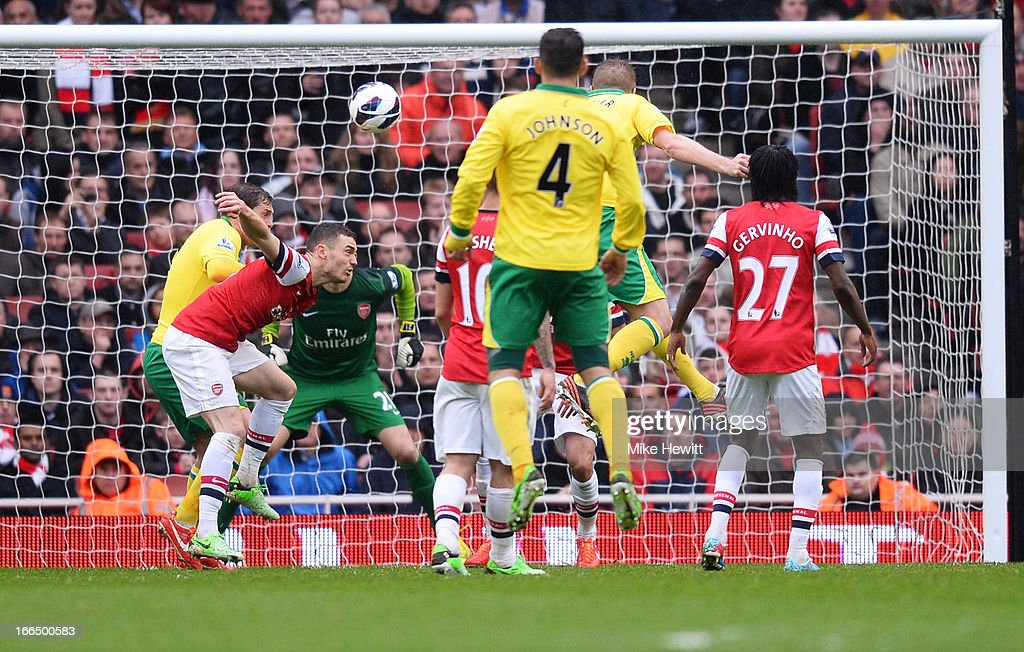 Michael Turner of Norwich City scores the first goal of the match during the Barclays Premier League match between Arsenal and Norwich City at Emirates Stadium on April 13, 2013 in London, England.