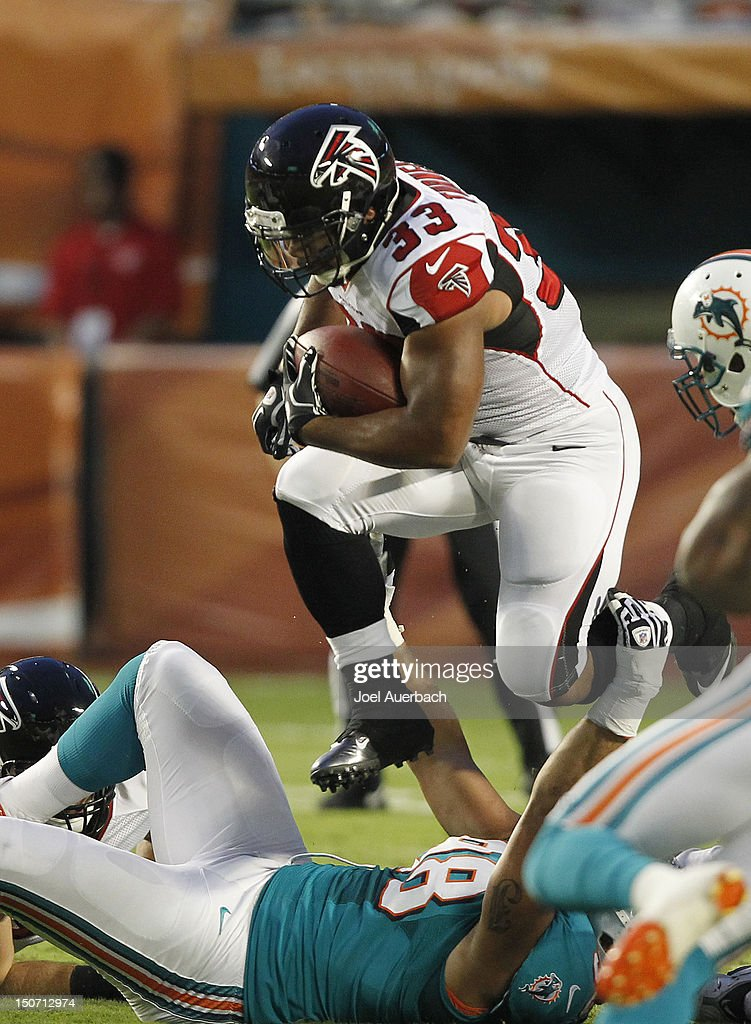 Michael Turner #33 of the Atlanta Falcons runs with the ball against the Miami Dolphins during a preseason game on August 24, 2012 at Sun Life Stadium in Miami Gardens, Florida. The Falcons defeated the Dolphins 23-6.