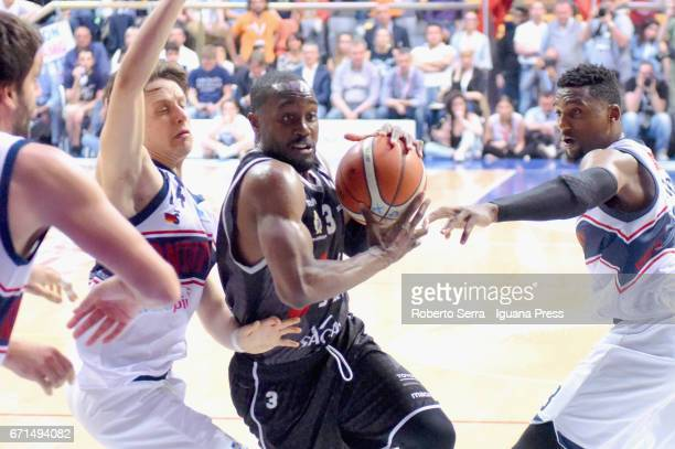 Michael Umeh of Segafredo competes with Matteo Montano and Alex Legion of Kontatto during the LegaBasket LNP of serie A2 match between Fortitudo...