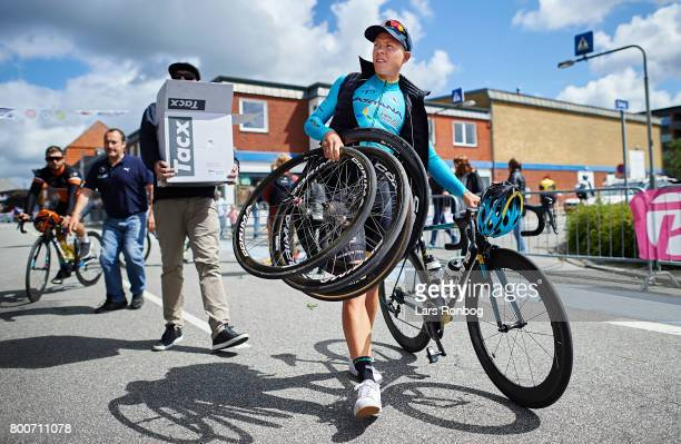 Michael Valgren Andersen of Astana Pro Cycling walks with his spare wheels prior to the Elite Mens Road Race in the Danish Road Cycling Championships...