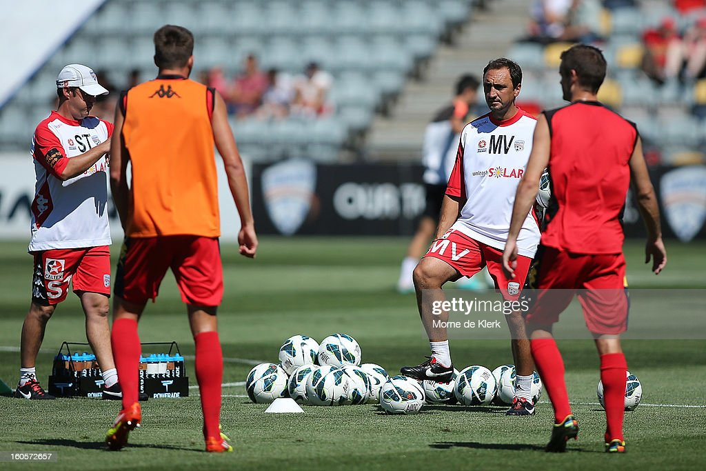 Michael Valkanis (2R), interim coach of Adelaide, watches as the players warm up before the round 19 A-League match between Adelaide United and the Western Sydney Wanderers at Hindmarsh Stadium on February 3, 2013 in Adelaide, Australia.