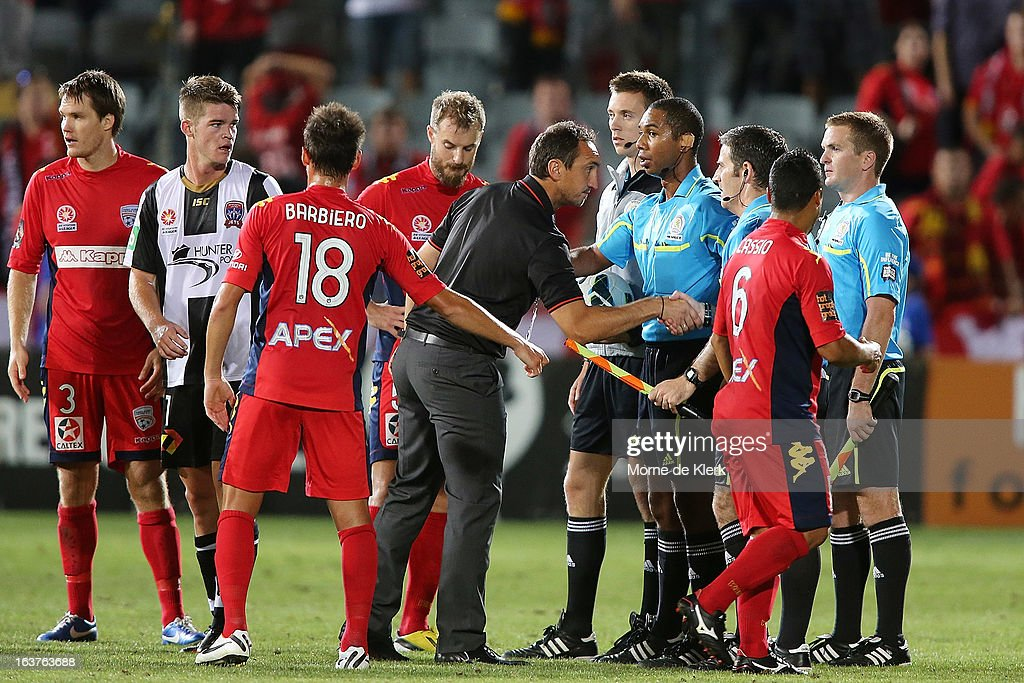 Michael Valkanis of Adelaide shakes the hand of an assistant referee directly after the round 25 A-League match between Adelaide United and the Newcastle Jets at Hindmarsh Stadium on March 15, 2013 in Adelaide, Australia.