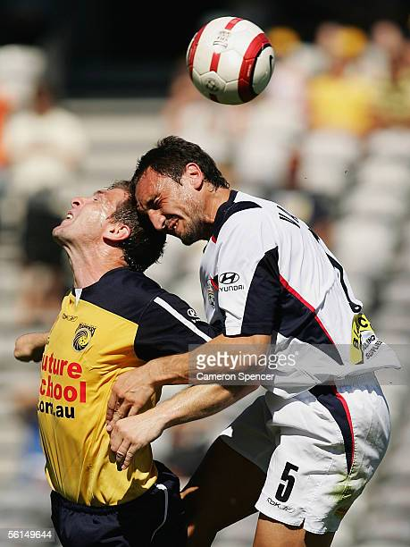 Michael Valkanis of Adelaide United and Stewart Petrie of the Mariners contest the ball during the round 12 ALeague match between the Central Coast...