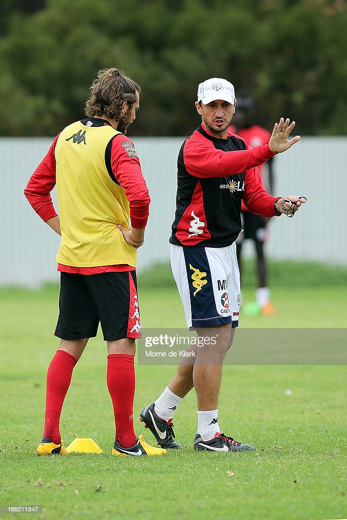 Michael Valkanis (R) talks to Jonathan McKain during an Adelaide United A-League training session at the South Australian Sports Institute on April 2, 2013 in Adelaide, Australia.