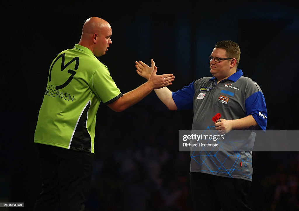 <a gi-track='captionPersonalityLinkClicked' href=/galleries/search?phrase=Michael+van+Gerwen&family=editorial&specificpeople=4754172 ng-click='$event.stopPropagation()'>Michael van Gerwen</a> (L) consoles Rene Eidams after narrowly beating Eidams in their first round match on day two of the 2016 William Hill PDC World Darts Championships at Alexandra Palace on December 18, 2015 in London, England.
