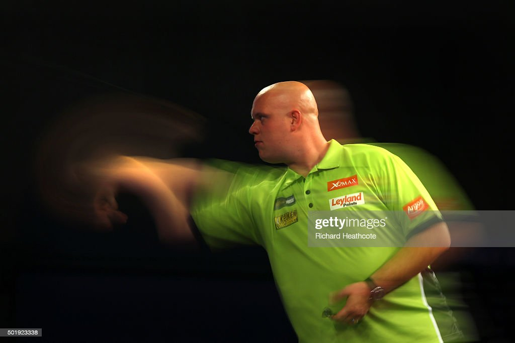<a gi-track='captionPersonalityLinkClicked' href=/galleries/search?phrase=Michael+van+Gerwen&family=editorial&specificpeople=4754172 ng-click='$event.stopPropagation()'>Michael van Gerwen</a> in action during his first round match against Rene Eidams on day two of the 2016 William Hill PDC World Darts Championships at Alexandra Palace on December 18, 2015 in London, England.