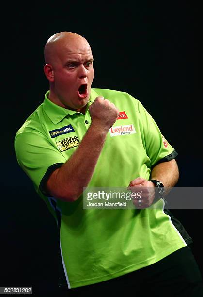 Michael van Gerwen of Holland celebrates a point in his third round match against Raymond van Barneveld of Holland on Day Eleven of the 2016 William...