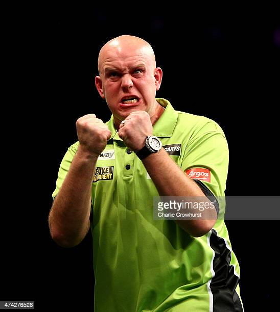 Michael van Gerwen of Holland celebrates winning his semi final match against Raymond van Barneveld of Holland during the Betway Premier League at...
