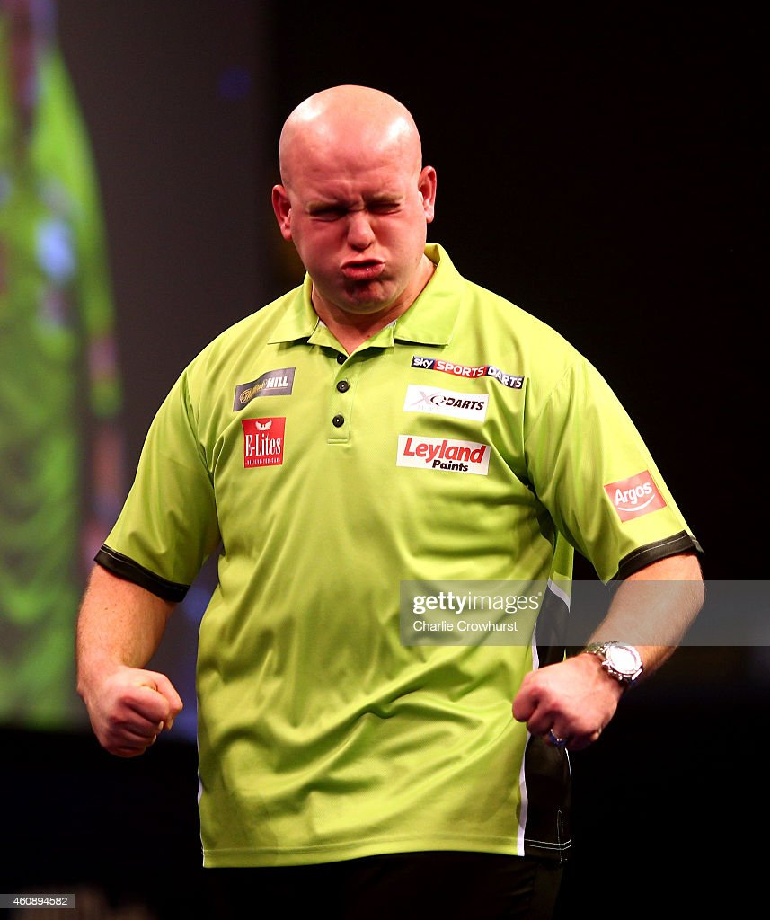 <a gi-track='captionPersonalityLinkClicked' href=/galleries/search?phrase=Michael+van+Gerwen&family=editorial&specificpeople=4754172 ng-click='$event.stopPropagation()'>Michael van Gerwen</a> of Holland celebrates winning his third round match against Terry Jenkins of England during the William Hill PDC World Darts Championships on Day Nine at Alexandra Palace on December 29, 2014 in London, England.