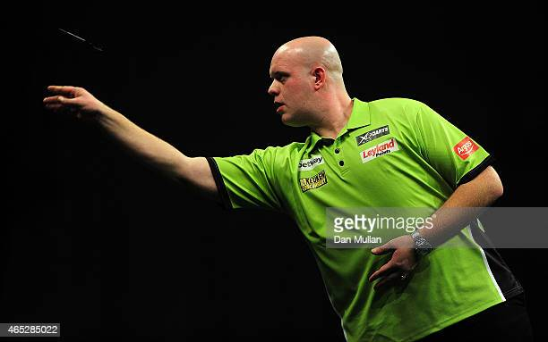 Michael van Gerwen of Holland competes against Peter Wright of Scotland during The Betway Premier League Darts at Westpoint Arena on March 5 2015 in...