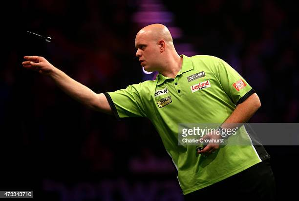 Michael van Gerwen of Holland in action during his match against Dave Chisnall of England during the Betway Premier League at The Brighton Centre on...