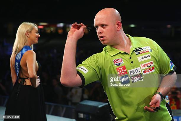 Michael van Gerwen of Holland in action during the final between Simon The Wizard Whitlock and Mighty Michael van Gerwen during the Invitational...