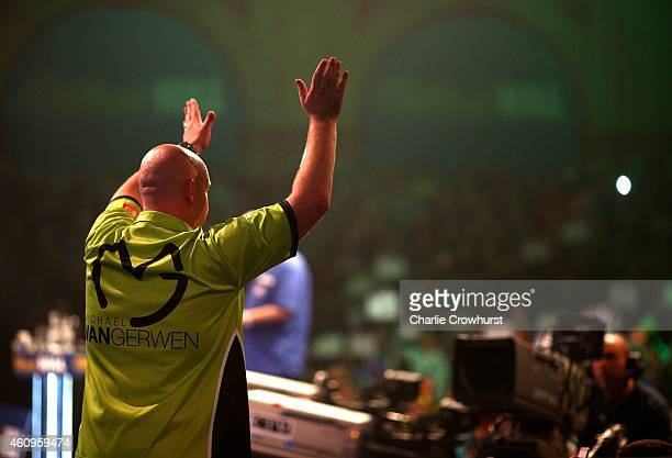 Michael van Gerwen of Holland makes his entrance during his quarter final match against Robert Thornton of Scotland during the William Hill PDC World...