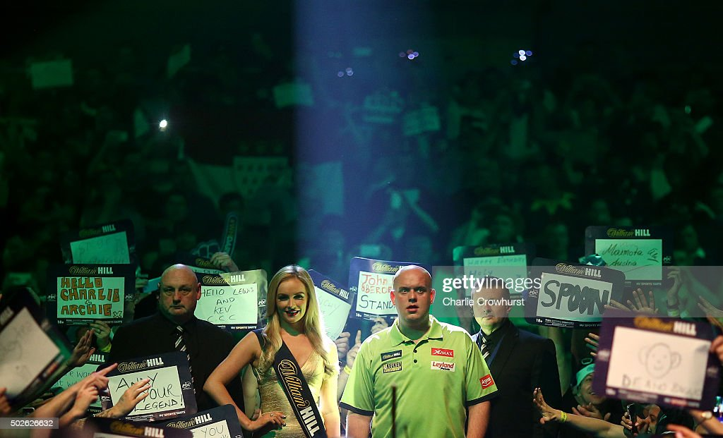 <a gi-track='captionPersonalityLinkClicked' href=/galleries/search?phrase=Michael+van+Gerwen&family=editorial&specificpeople=4754172 ng-click='$event.stopPropagation()'>Michael van Gerwen</a> of Holland makes his entrance during his second round match against Darren Webster of England during the 2016 William Hill PDC World Darts Championships on Day Nine at Alexandra Palace on December 27, 2015 in London, England.