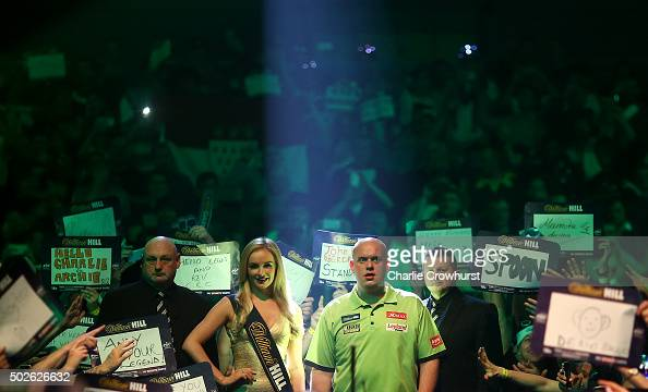 Michael van Gerwen of Holland makes his entrance during his second round match against Darren Webster of England during the 2016 William Hill PDC...